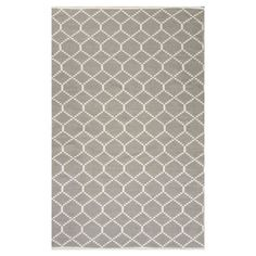 Equally at home in your foyer or on the patio, this woven indoor/outdoor rug showcases a classic geometric trellis motif.   Product: