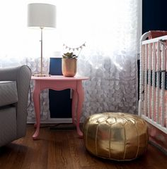 Navy and Coral Nursery with Gold Pouf -  Want a pop of gold? Try adding the metallic tone in your decor!