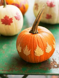 Decoupage leaves onto pumpkins via BHG. Might be pretty on painted or metallic pumpkins also