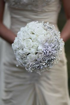 cinderella style wedding bouquet. love the winter look with a purple ribbon around the stems