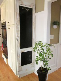 old door with chalkboard paint - perfect for end of kitchen cupboards
