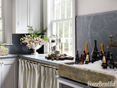 soapstone backsplash, stone sink and brass hardware & faucet