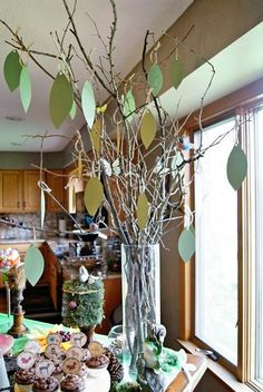 "our ""advice tree"" with paper leaves.....each guest wrote a piece of advice for the mother to be on a leaf.  I then tied them together with a pretty ribbon for her to keep."