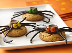 Cute spider cookies. Could switch the peanut butter cookie for a cinnamon one and the black liquorice for red.