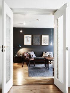 The dark grey wall