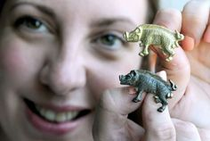 York Press: Natalie McCaul, the Yorkshire Museum's curator of archaeology, holds an original Richard III boar badge and the 18-carat gold re...