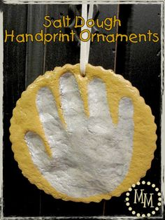 """Salt Dough Handprint Ornaments: 4 cups flour, 1 cup salt, 1.5 cups water. Stir until dough forms, knead 5-10 min. Should be sticky but not too dry. Roll to 1/4"""" thickness. Make handprint; use cookie cutter or cup/bowl to create edge. Poke hole in top. Place on parchment-lined baking pan. Bake @ 350 for 20 min. Cool for 20 min. Should feel firm, if not bake another 5-10 min. Decorate."""