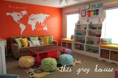 World Map Decal, Trellis patterned poufs, chevron valances - what's not to love about this magical orange and grey playroom?