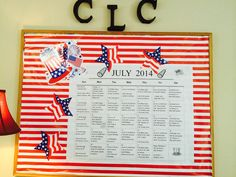 July Board - striped wrapping paper and cardboard cutouts from the Dollar Tree!