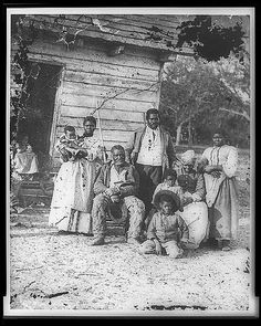 Black family on a plantation, slavery, slaves, history, photograph, photo b/w.