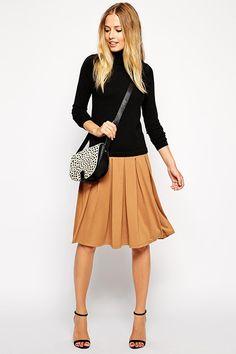 Midi skirt with box pleats and turtleneck #refinery29 http://www.refinery29.com/cheap-fall-wardrobe-essentials#slide39