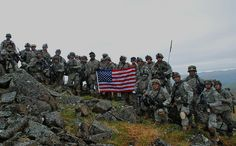 Soldiers assigned to 1st Battalion 5th Infantry Regiment, 1st Stryker Brigade Combat Team, 25th Infantry Division, Fort Wainwright Alaska, pose with an American flag at Fort Greely's Donnelly Training Area June 7, 2010. The Flag was donated by a Missouri Boy Scouts troop. (U.S. Army Photo By: Pfc. Thomas Duval 1-25 SBCT PAO)