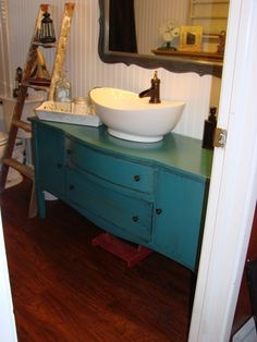 I like how they used an old dresser to make a bathroom vanity