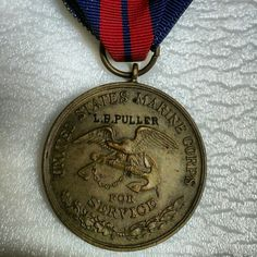 "This Second Haitian Campaign medal was issued to an aggressive young Marine NCO.  As a corporal, Lewis B. Puller received orders to serve as a lieutenant in the Gendarmerie d'Haiti.  He participated in over forty engagements.    The First Haitian Campaign medal looks very similar to the second, but the date on the obverse reads ""1915"" where the second reads ""1919-1920.""  In this photo you see the reverse face of the pendant.   Semper Fidelis  #USMC #USA #NMMC #USMCmuseum #Marines #Haiti #HaitianCampaign #Gendarmerie #BananaWars #ChestyPuller #SemperFi"