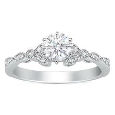 Perfection. Engagement Ring - Round Diamond Floral Vintage Engagement Ring 0.20 tcw. In 14K White Gold - ES269