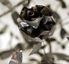 Like a snapshot from the #AddamsFamily , imagine a black or red vase full of these shiny, black roses. You can even #create them with your old Addams Family VHS! It's #Halloween #decor for the savvy #recycled crafts crowd! http://www.craftside.net/2014/09/halloween-inspriation-black-rose-made.html