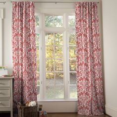 Drapes in Coral and Mint Damask by Carousel Designs.  To give your window a modern, clean tailored look, try our Hidden Back Tab Drapes. The hidden belt loops on the back create soft pleats without having to use hooks. They are extremely versatile and can be hung by placing a decorative rod through the tabs on the back of the drapes. If you prefer, you can use the rod pocket in the back to create a fuller gathered style of drape.