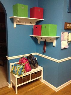 Kitchen mini-makeover. Added storage bench with cubbies for my kids, and made some wood shelves with coat hooks and fabric bins to keep the family organized.