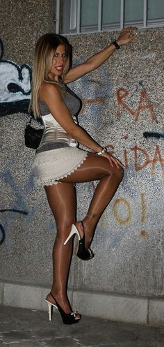 she is wearing the most beautiful pair of shiny pantyhose I've ever seen on a gorgeous woman