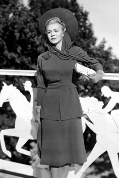 DAY AT THE RACES: 50 YEARS OF HATS & HORSES AROUND THE GLOBE - 1941: Carole Landis