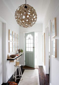 Cute idea for narrow entry hall. Love the natural light, the color of the door, and the mounted shelf.
