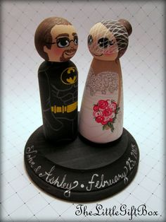 Superhero and His Bride / Wedding Cake Topper/ Custom Painted Wood Peg Dolls with Plaque. $54.95, via Etsy.