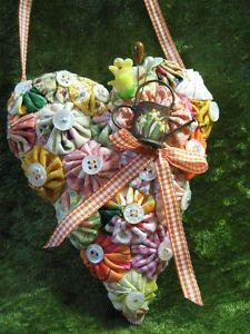 heart pincushion, yo yos, christmas decorations, vintage fabrics, yoyo heart, new kitchens, sewing art, fabric yoyo, buttons and bows crafts