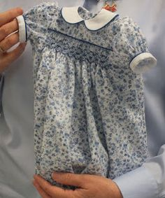 "Smocked dress for 18"" doll."