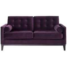 """Tufted velvet loveseat with a wood frame.     Product:  Loveseat  Construction Material: Wood and velvet Color:  Purple   Features:   Transitional style   Sleek and low button back Dimensions: 34"""" H x 68"""" W x 36"""" D"""