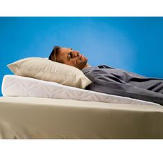 The Sleep Improving Pillow Wedge - Hammacher Schlemmer - This gently sloped pillow provides a subtle incline that raises the upper body for relief from the symptoms of heartburn, sinus congestion, and snoring.