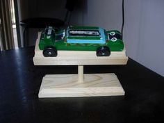 Great tutorial for making Pinewood Derby Car Stands http://www.instructables.com/id/Pinewood-Derby-Trophy-Stand/