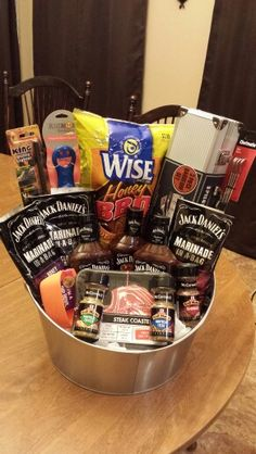 Barbecue Raffle Basket. I made this barbecue basket for a fundraiser at school. All the barbecue sauces, marinades, and rubs are placed in a beverage tub. It will be wrapped up in cellophane and a big bow.