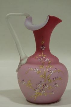 Victorian Art Glass Ewer - Gold gilt and enameling floral spray, dark pink to light pink exterior, white interior, opaque handle