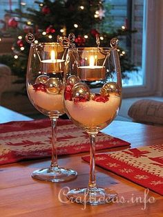 Christmas Glow  ~~~ Tea-lights & ornaments in a Wine Glass. ~ This could easily work with sand at the bottom or small pebbles or even some beads instead of the artificial snow.