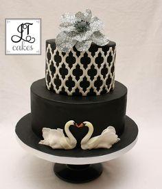 Black cake with white lattice & two swans