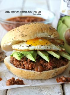 SLOPPY JOES with AVOCADO & FRIED EGG • Ingredients • Tomato Sauce: 15-oz can tomato sauce, 3 Tb brown sugar, 1½ Tb red wine vinegar, 1 Tb Worcestershire, 1 Tb Dijon, 1-2 tsp crushed red pepper flakes, 2 Tb tomato paste • Meat Mix: 2 Tb vegetable oil {for sautéing}, 1 small diced onion, 2 minced garlic cloves, 2 tsp chili powder, 1 lb ground sirloin, Kosher salt, Freshly ground black pepper • Sandwich: 4 toasted hamburger buns, 4 fried eggs, Sliced avocado