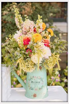 Wedding Flowers, Wild Flowers In A Watering Can: rustic flowers for weddings