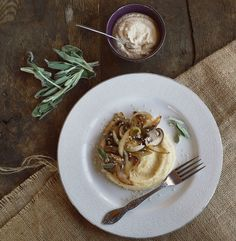 Creamy polenta topped with sweet caramelized onions, cashew cream and smoky mushrooms! (gluten free, vegan)
