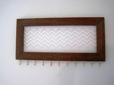 Jewelry Hanger / Organizer / Chevron Lace / Vintage Wood Frame / Rugged / Rustic / Shabby Shiek / With Hooks. $30.00, via Etsy.