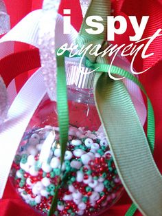 an I Spy ornament!! #DIY #craft #Christmas #tree #ornament #plastic #ribbon #beads #red #green #white #kid #kids #gift #gifts #little #hands #ISpy