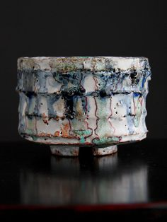 Rosslare    Rice Bowl    Shino and glass combine with cobalt blue and iron oxide to make a great surface on this cup/bowl. Made from clay pulled from Texas soil and fired to cone 10.