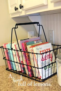Cookbooks in a basket. Great idea!