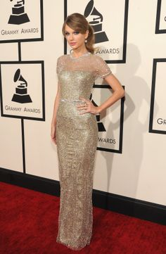 Taylor Swift in a Gucci gold mesh and crystal Première gown at the 56th Annual Grammy Awards