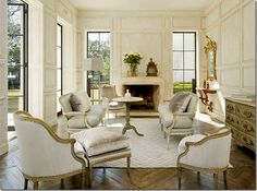 I love the wooden floors and the white french chairs.