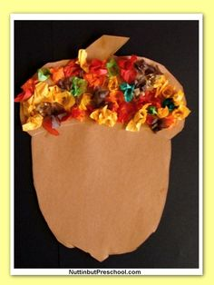 I love tissue paper art, because it's so easy, and the kids love it! Make a construction paper acorn and have the kids decorate the top!