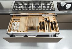 Shallow drawer inside a deeper drawer - daily utensils on top w/ silver below or cooking implements on both levels
