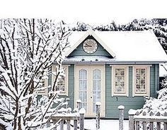 Blue cottage and a snowy day....