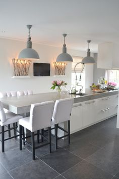 extended island = eat-in kitchen...no need for dining table, can make into family room