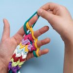 Knitting with Kids...  how to finger knit a multi-colored jump rope!