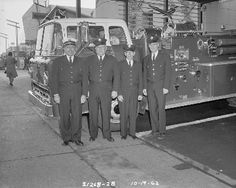 Firefighters with fire truck, 1962